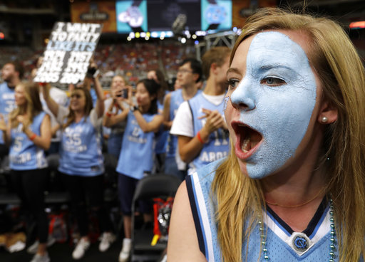 "<div class=""meta image-caption""><div class=""origin-logo origin-image none""><span>none</span></div><span class=""caption-text"">North Carolina fans cheer. (AP Photo/David J. Phillip)</span></div>"