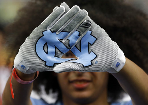 "<div class=""meta image-caption""><div class=""origin-logo origin-image none""><span>none</span></div><span class=""caption-text"">A North Carolina fan shows off her gloves. (AP Photo/David J. Phillip)</span></div>"