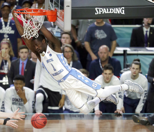 <div class='meta'><div class='origin-logo' data-origin='none'></div><span class='caption-text' data-credit=''>North Carolina's Theo Pinson (1) dunks. (AP Photo/Matt York)</span></div>