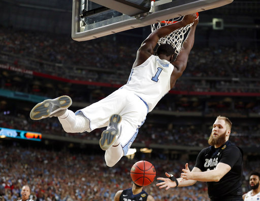 "<div class=""meta image-caption""><div class=""origin-logo origin-image none""><span>none</span></div><span class=""caption-text"">North Carolina's Theo Pinson (1) dunks. (AP Photo/Charlie Neibergall)</span></div>"