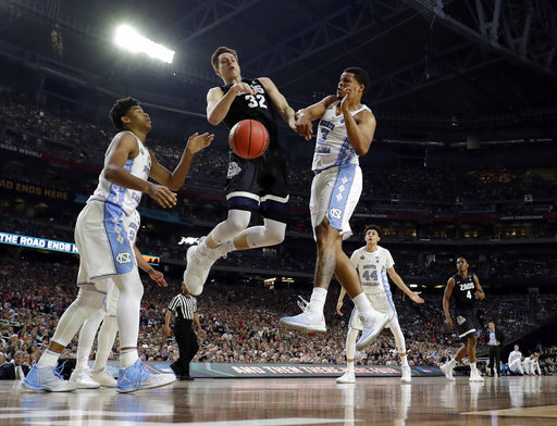 "<div class=""meta image-caption""><div class=""origin-logo origin-image none""><span>none</span></div><span class=""caption-text"">Gonzaga's Zach Collins (32) battles for a rebound against North Carolina's Kennedy Meeks (3). (AP Photo/David J. Phillip)</span></div>"