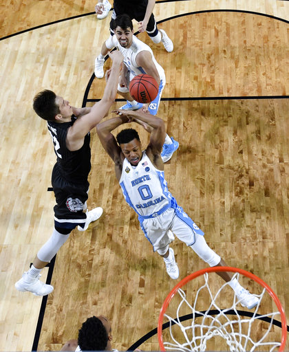 "<div class=""meta image-caption""><div class=""origin-logo origin-image none""><span>none</span></div><span class=""caption-text"">Gonzaga's Zach Collins blocks a shot by North Carolina's Nate Britt (0). (AP Photo/Chris Steppig, Pool)</span></div>"