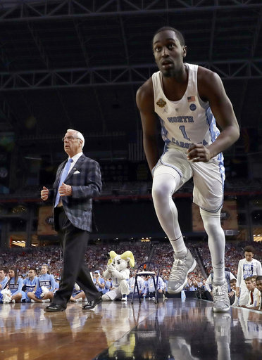 "<div class=""meta image-caption""><div class=""origin-logo origin-image none""><span>none</span></div><span class=""caption-text"">North Carolina's Theo Pinson (1) takes the court as head coach Roy Williams watches. (AP Photo/David J. Phillip)</span></div>"