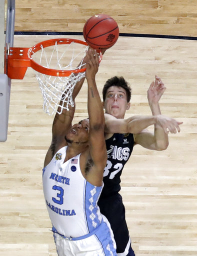 <div class='meta'><div class='origin-logo' data-origin='none'></div><span class='caption-text' data-credit=''>North Carolina's Kennedy Meeks (3) shoots against Gonzaga's Zach Collins. (AP Photo/David J. Phillip)</span></div>