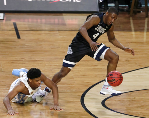 "<div class=""meta image-caption""><div class=""origin-logo origin-image none""><span>none</span></div><span class=""caption-text"">Gonzaga's Jordan Mathews (4) grabs a loose ball against North Carolina's Isaiah Hicks. (AP Photo/Matt York)</span></div>"