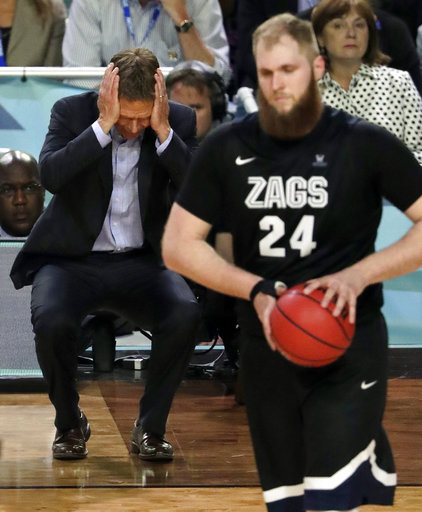 <div class='meta'><div class='origin-logo' data-origin='none'></div><span class='caption-text' data-credit=''>Gonzaga head coach Mark Few reacts as Przemek Karnowski (24) walks down on the court. (AP Photo/Matt York)</span></div>