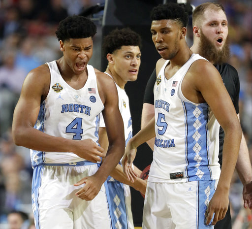 "<div class=""meta image-caption""><div class=""origin-logo origin-image none""><span>none</span></div><span class=""caption-text"">North Carolina's Isaiah Hicks (4) and Tony Bradley (5) react to a call. (AP Photo/Mark Humphrey)</span></div>"