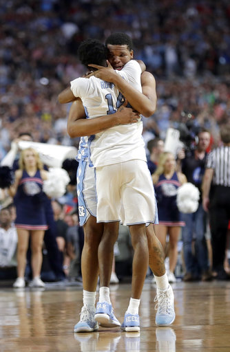 "<div class=""meta image-caption""><div class=""origin-logo origin-image none""><span>none</span></div><span class=""caption-text"">North Carolina's Kennedy Meeks embraces with Brandon Robinson (14). (AP Photo/David J. Phillip)</span></div>"