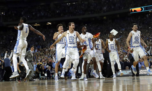 <div class='meta'><div class='origin-logo' data-origin='none'></div><span class='caption-text' data-credit=''>North Carolina players celebrate. (AP Photo/David J. Phillip)</span></div>