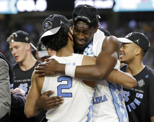 <div class='meta'><div class='origin-logo' data-origin='none'></div><span class='caption-text' data-credit=''>North Carolina's Joel Berry II (2) and Theo Pinson celebrate. (AP Photo/David J. Phillip)</span></div>
