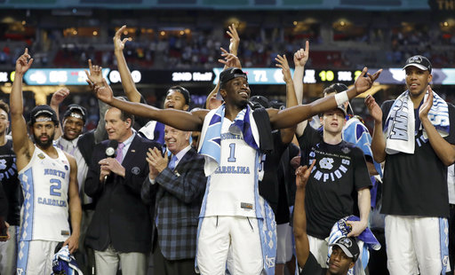 <div class='meta'><div class='origin-logo' data-origin='none'></div><span class='caption-text' data-credit=''>North Carolina's Theo Pinson (1) and the rest of the team celebrate. (AP Photo/David J. Phillip)</span></div>