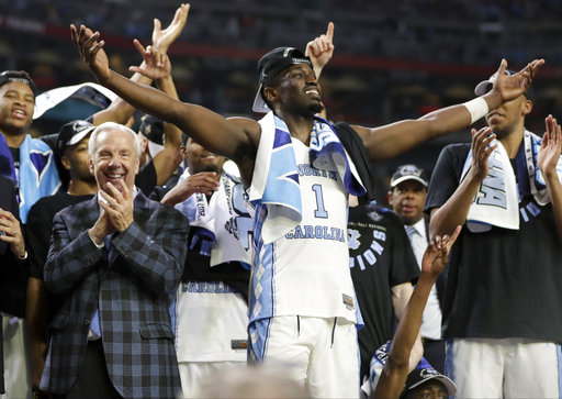 "<div class=""meta image-caption""><div class=""origin-logo origin-image none""><span>none</span></div><span class=""caption-text"">North Carolina's Theo Pinson (1) celerates with head coach Roy Williams and the rest of the players. (AP Photo/Mark Humphrey)</span></div>"