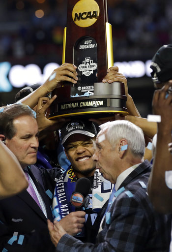 "<div class=""meta image-caption""><div class=""origin-logo origin-image none""><span>none</span></div><span class=""caption-text"">North Carolina head coach Roy Williams is interviewed as his team celebrates. (AP Photo/David J. Phillip)</span></div>"
