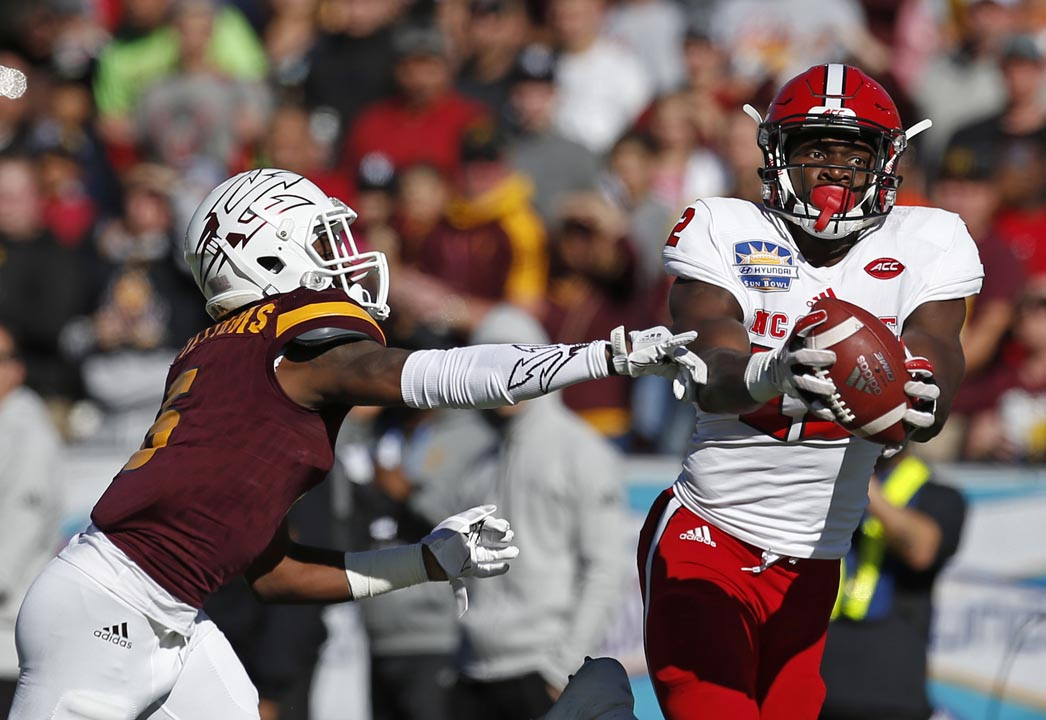 <div class='meta'><div class='origin-logo' data-origin='AP'></div><span class='caption-text' data-credit='Andres Leighton'>North Carolina State wide receiver Stephen Louis, right, catches a pass against Arizona State defensive back Kobe Williams.</span></div>