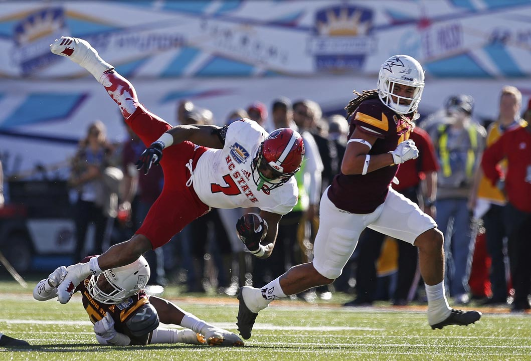 <div class='meta'><div class='origin-logo' data-origin='AP'></div><span class='caption-text' data-credit='Andres Leighton'>North Carolina State running back Nyheim Hines (7) scored three 5-yard touchdowns and was named MVP of the Sun Bowl.</span></div>
