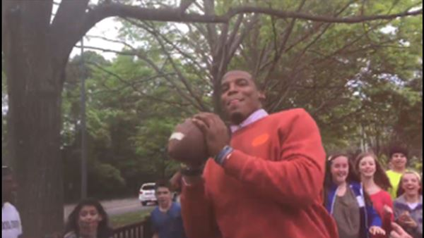 <div class='meta'><div class='origin-logo' data-origin='none'></div><span class='caption-text' data-credit='image courtesy WSOC'>Cam Newton plays football with Davidson seventh-graders</span></div>