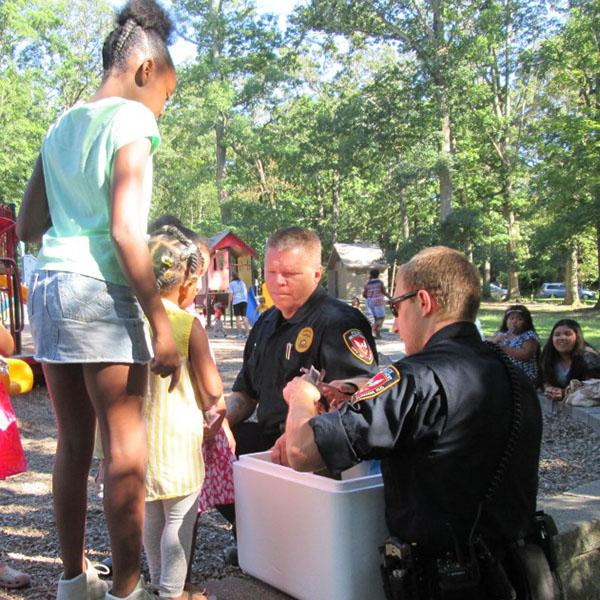 <div class='meta'><div class='origin-logo' data-origin='none'></div><span class='caption-text' data-credit='Durham Police Department'>Durham police officers giving over 500 freeze pops to local kids.</span></div>