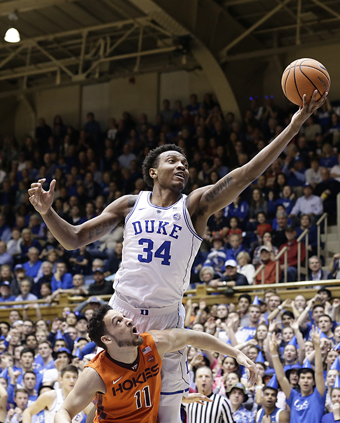 Duke's Wendell Carter Jr. shoots over a Virginia Tech player