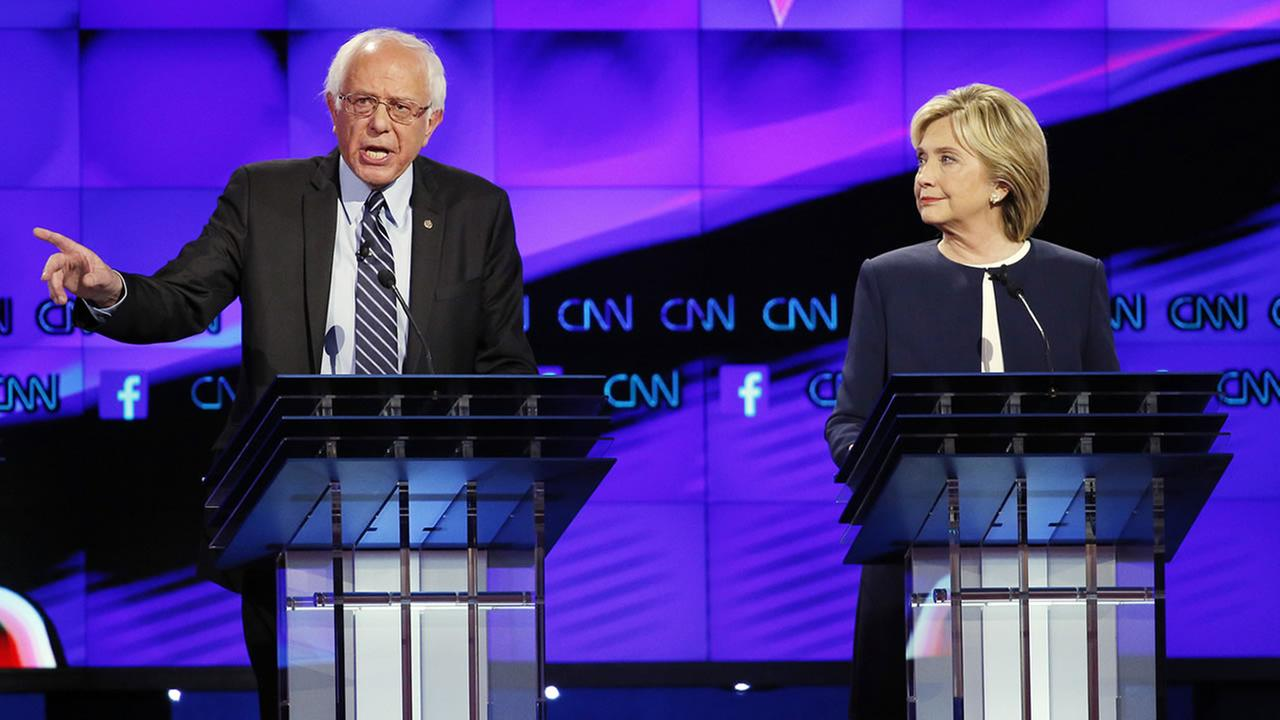 Hillary Rodham Clinton, right, listens as Sen. Bernie Sanders, of Vermont, speaks during the CNN Democratic presidential debate Tuesday, Oct. 13, 2015, in Las Vegas.