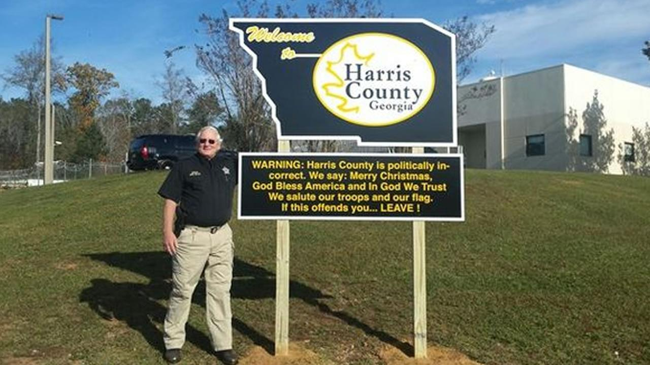 Harris County Sheriff Mike Jolley and his sign.