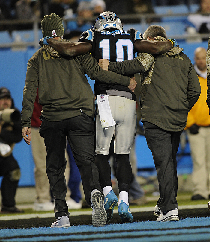 Carolina Panthers wide receiver Curtis Samuel is helped off the field after injuring his ankle against the Miami Dolphins on Monday