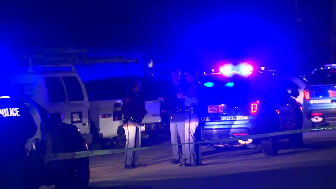 Police investigate at the scene of a shooting late Thursday in Raleigh.