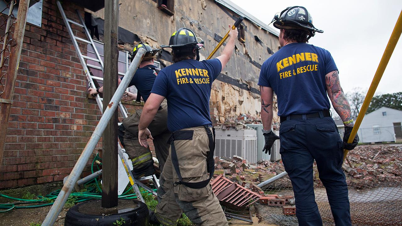 Members of the Kenner Fire Department knocks down bricks from the wall of the New Mount Bethel Baptist Church which suffered suffered weather damage in Kenner, La., Tuesday.