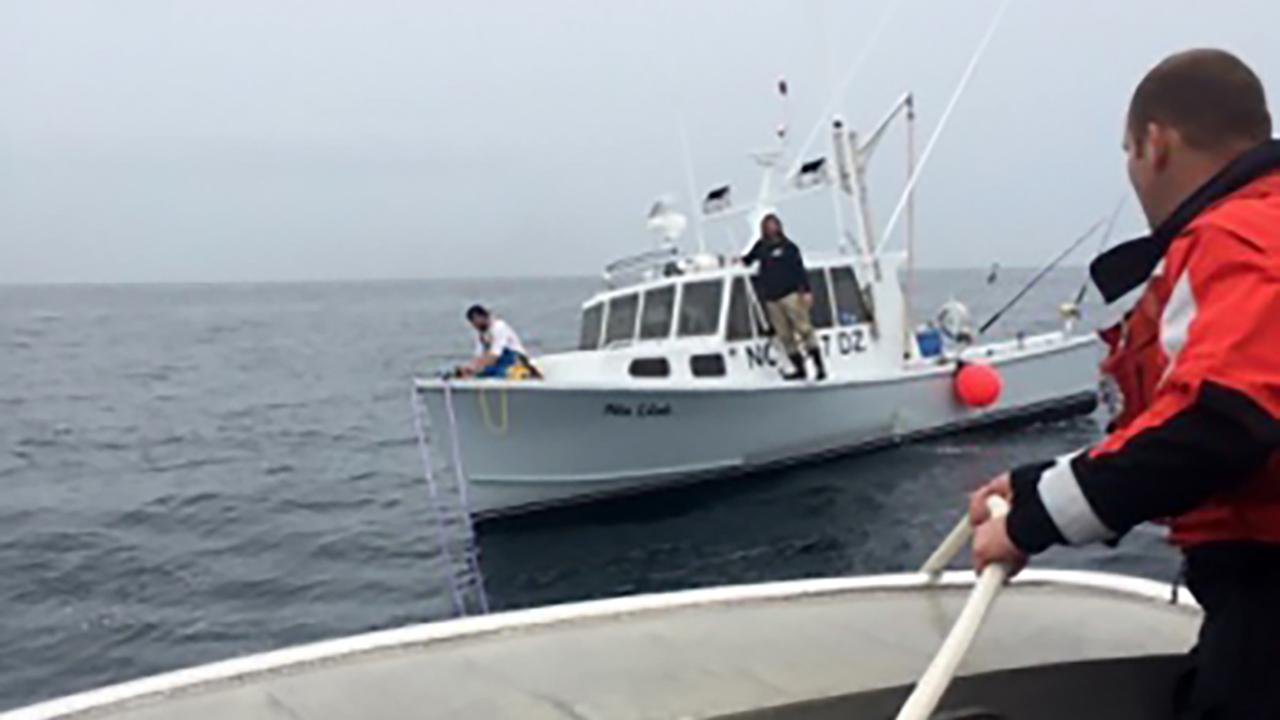 The Coast Guard towed in a disabled boat Sunday southeast of Oregon Inlet.