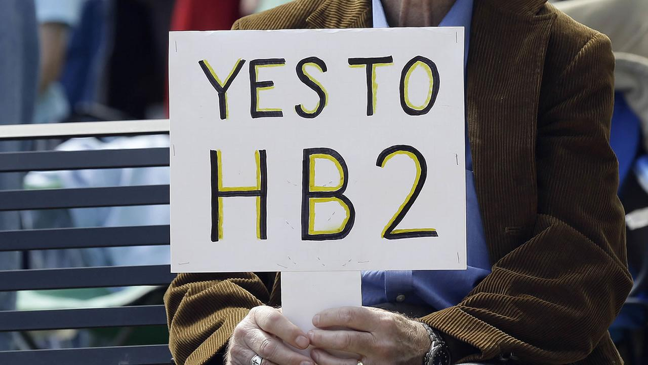 A supporter of House Bill 2 holds a sign during a Raleigh demonstration.