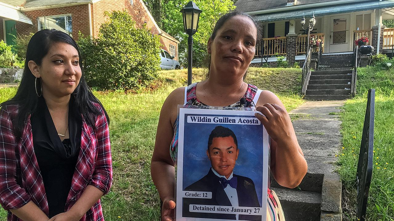 Dilsia Acosta holds a picture of her son.