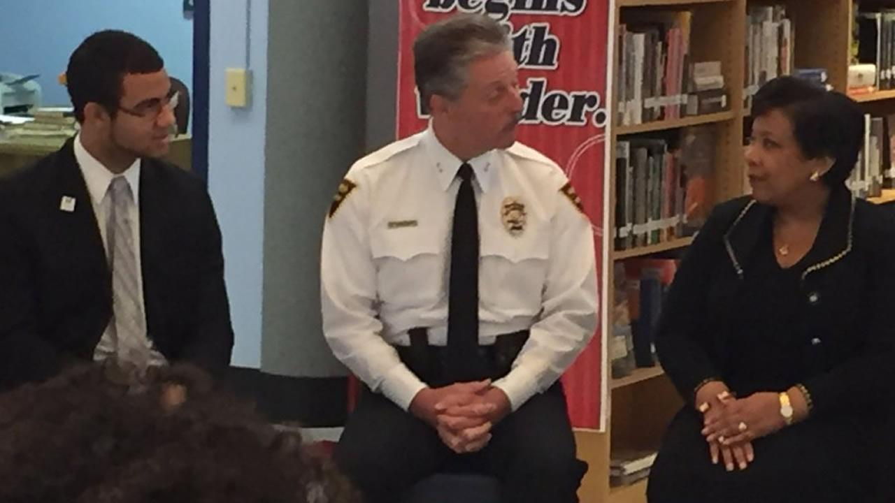 Fayetteville police Chief Harold Medlock with U.S. Attorney General Loretta Lynch (WTVD Photo/Greg Barnes)