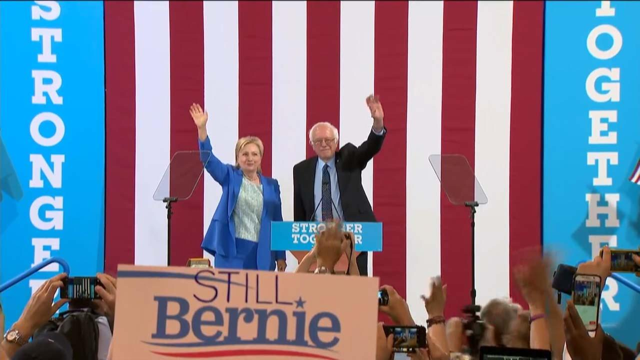 Hillary Clinton and Bernie Sanders campaign together