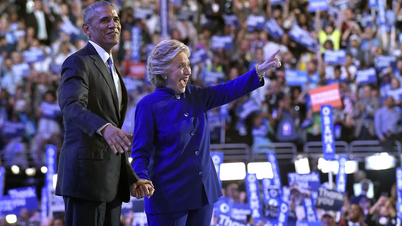President Barack Obama stands with Democratic presidential candidate Hillary Clinton following Obamas speech at the Democratic National Convention