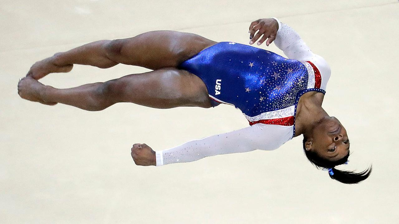 Gymnast 39 s performance sets the bar higher at rio games for Floor gymnastics