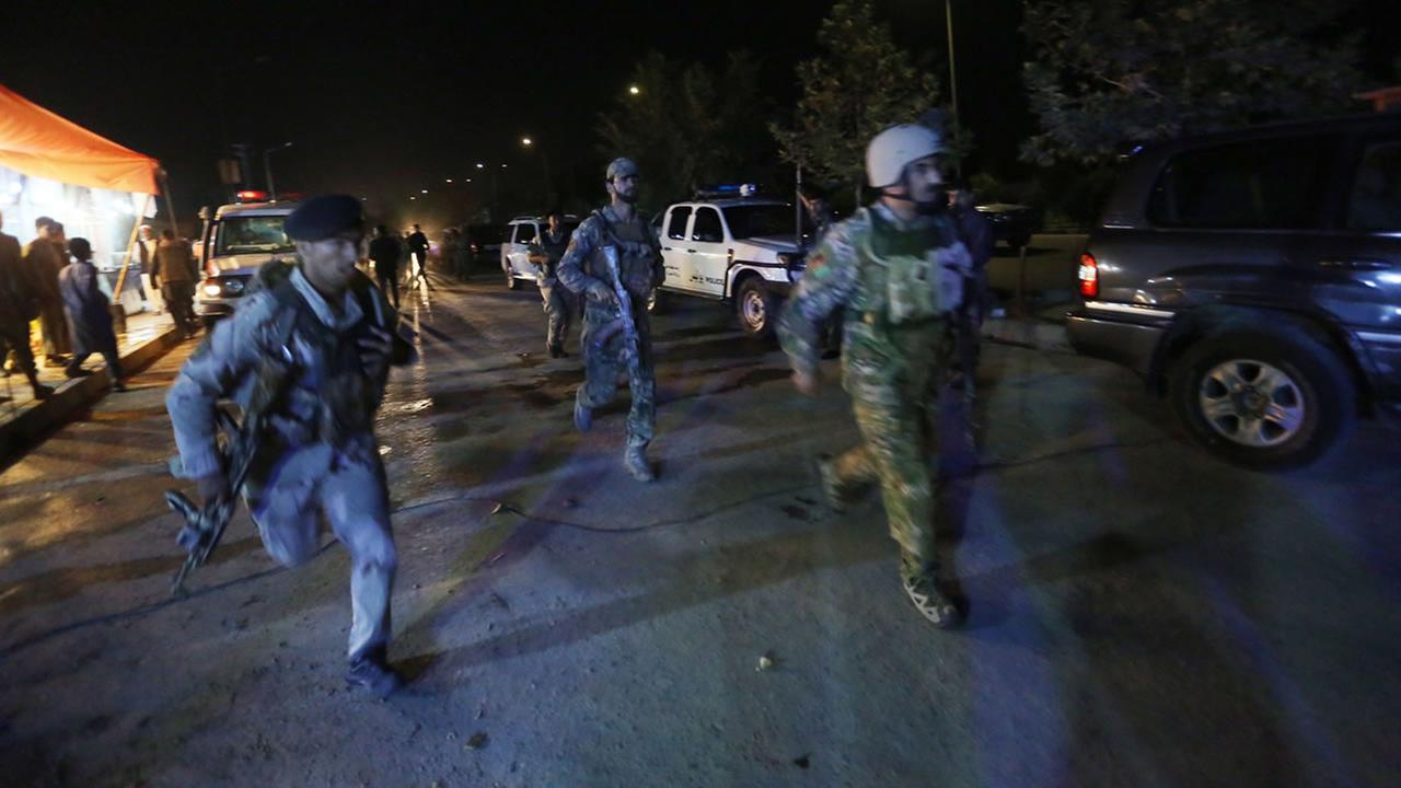 Afghan security forces rush to respond to a complex Taliban attack on the campus of the American University in the Afghan capital Kabul