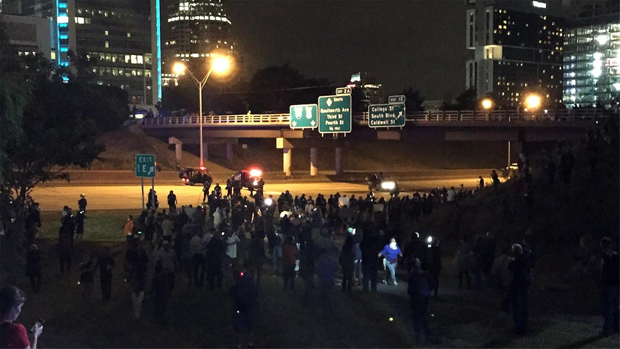 Police moved to get protesters off of I-277 in Charlotte.