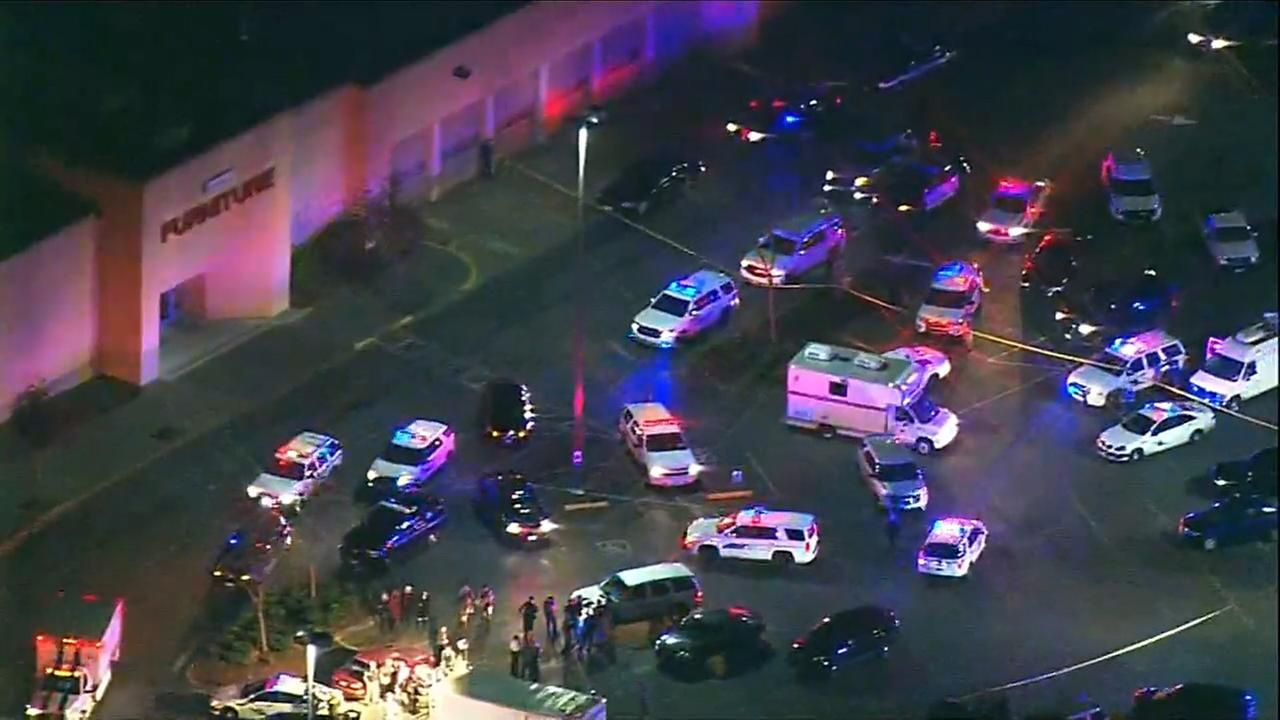 Police respond to a mall shooting in Burlington, Wash., on Friday night.
