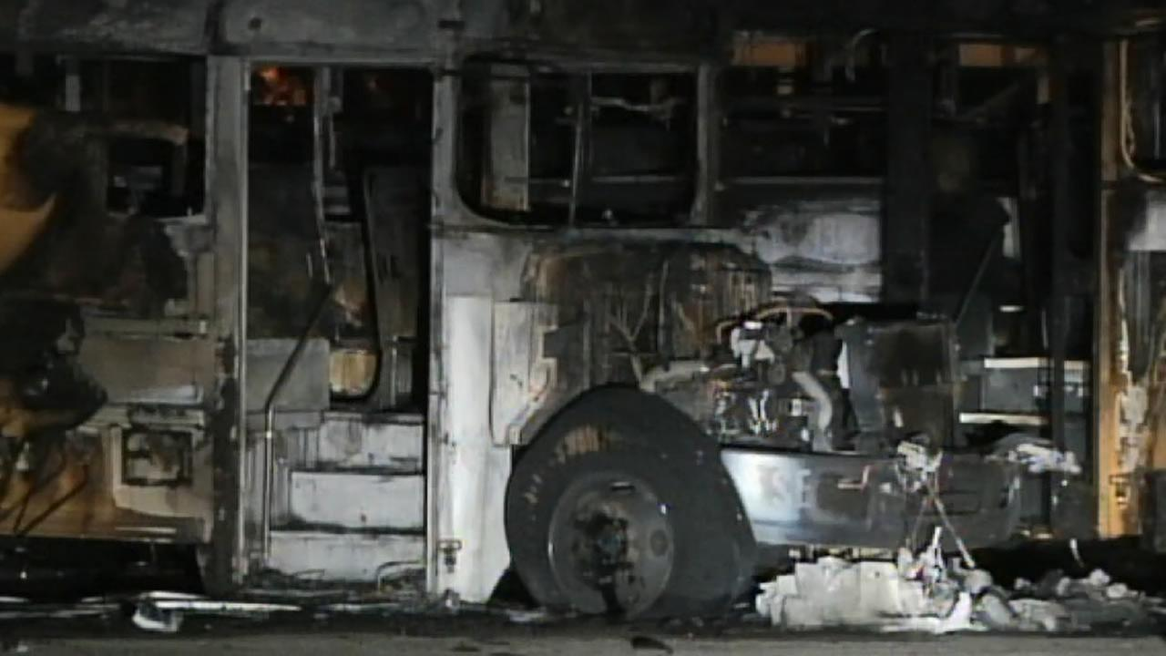 Burned Wake County school buses parked at Southeast Raleigh High School.