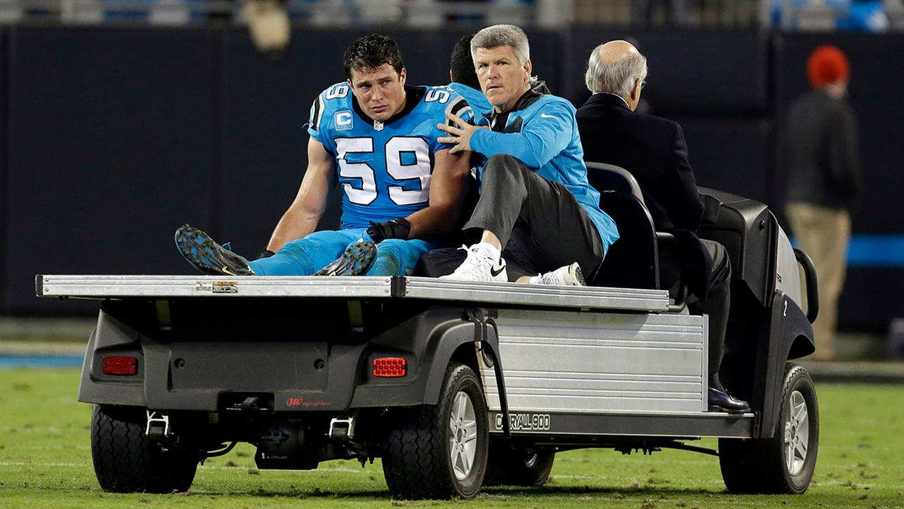 A teary-eyed and shaken Luke Kuechly (59) is taken off the field Nov. 17 against the Saints.