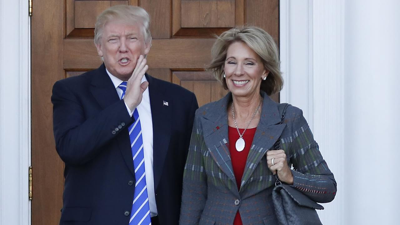 Donald Trump with Betsy Devos (AP image/Carolyn Kaster)