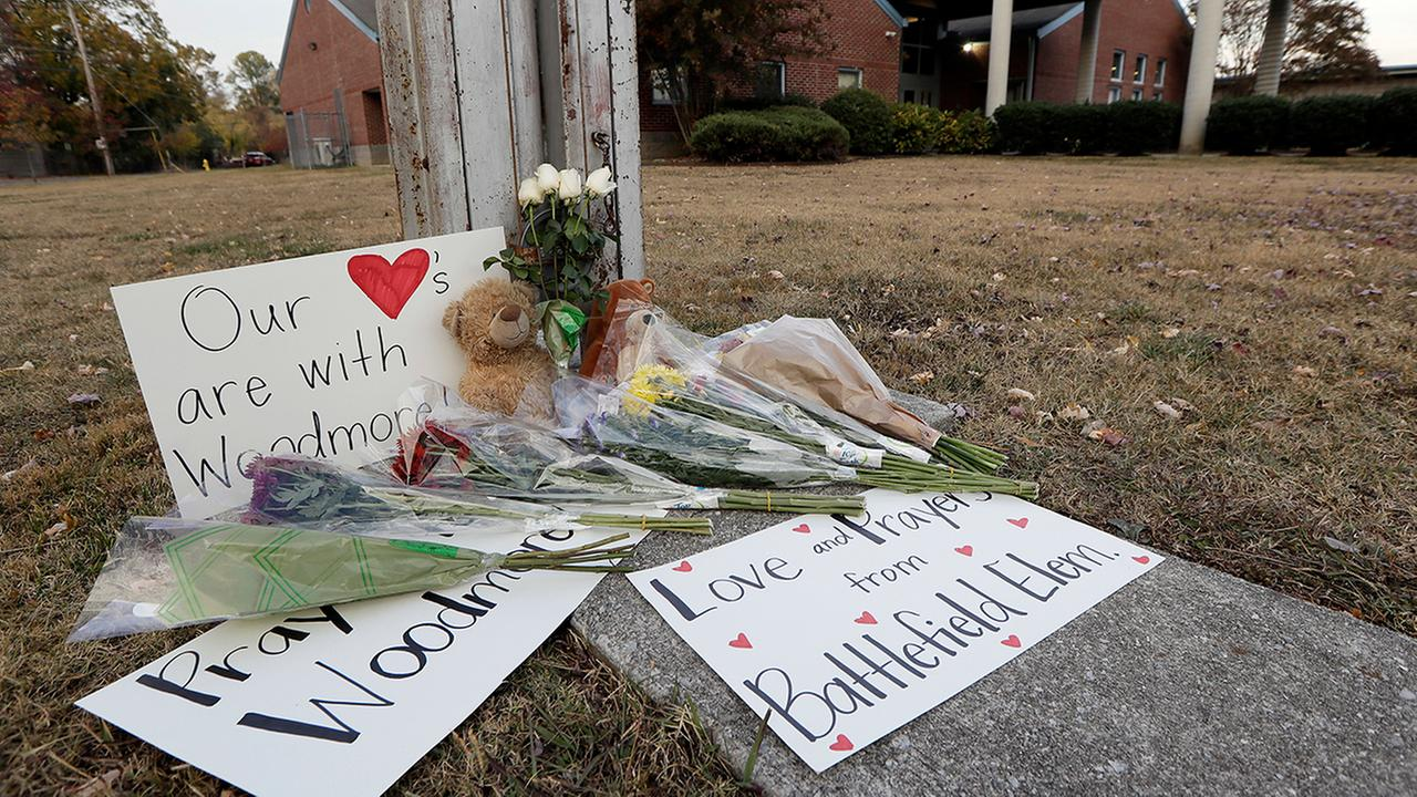 Flowers, signs and stuffed animals make up a makeshift memorial outside Woodmore Elementary School on Tuesday in Chattanooga, Tenn.