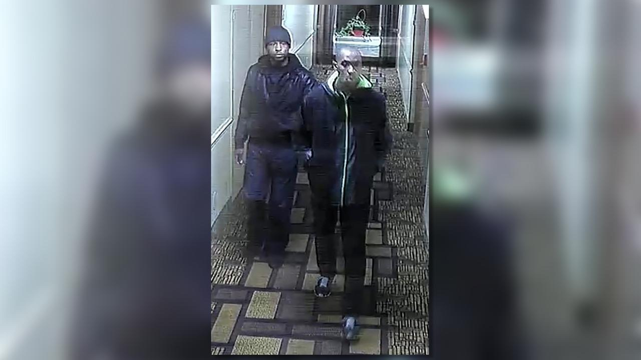 Police have released an image of these two suspects in the hotel.