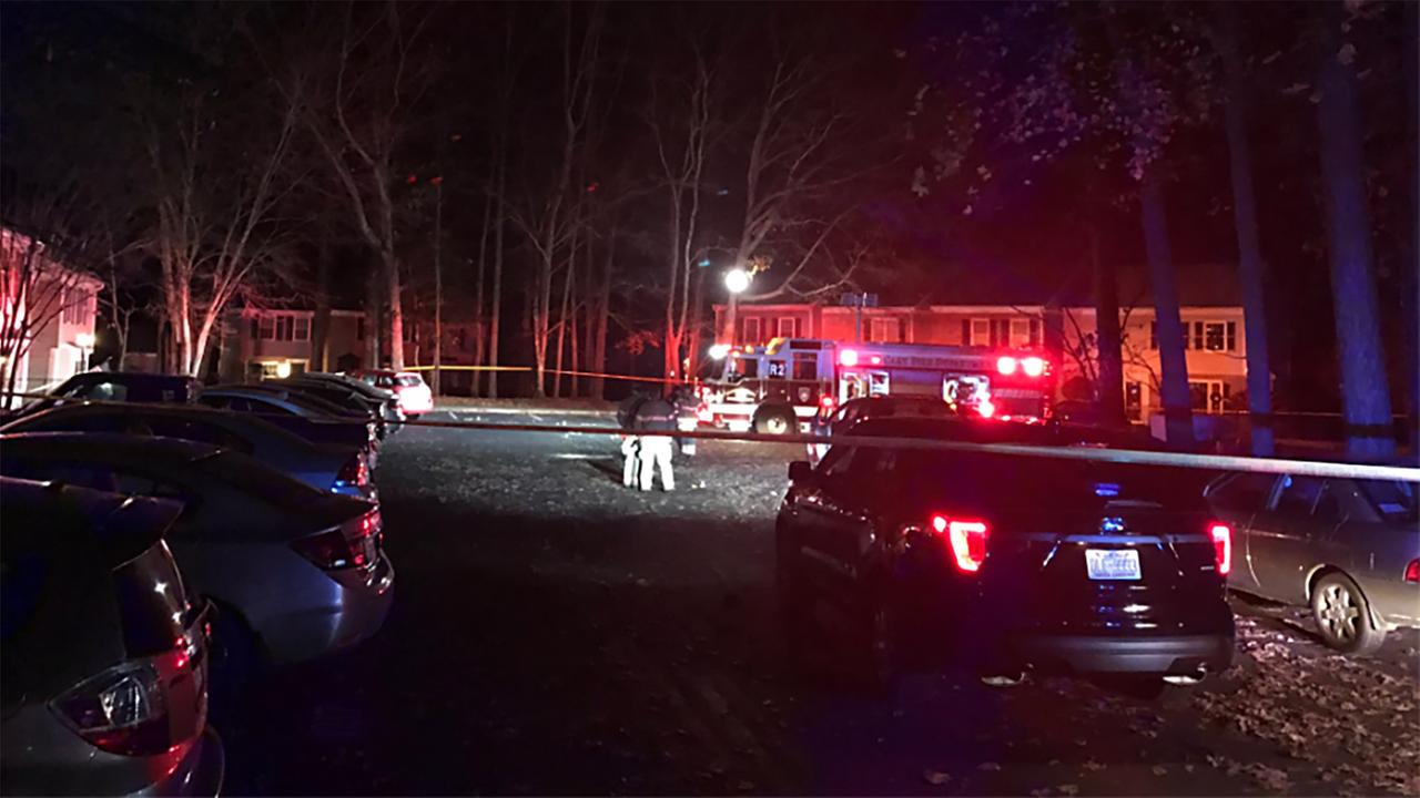 Police respond after a woman was shot in Cary.