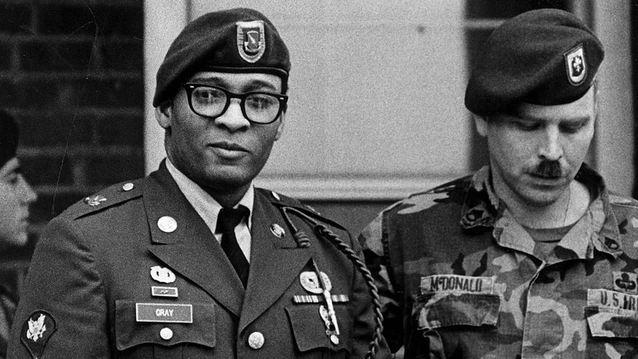 This April 1988 picture shows Ronald A. Gray escorted by military police leaving a Fort Bragg courtroom. (AP Photo/The Fayetteville Observer, Marcus Castro)