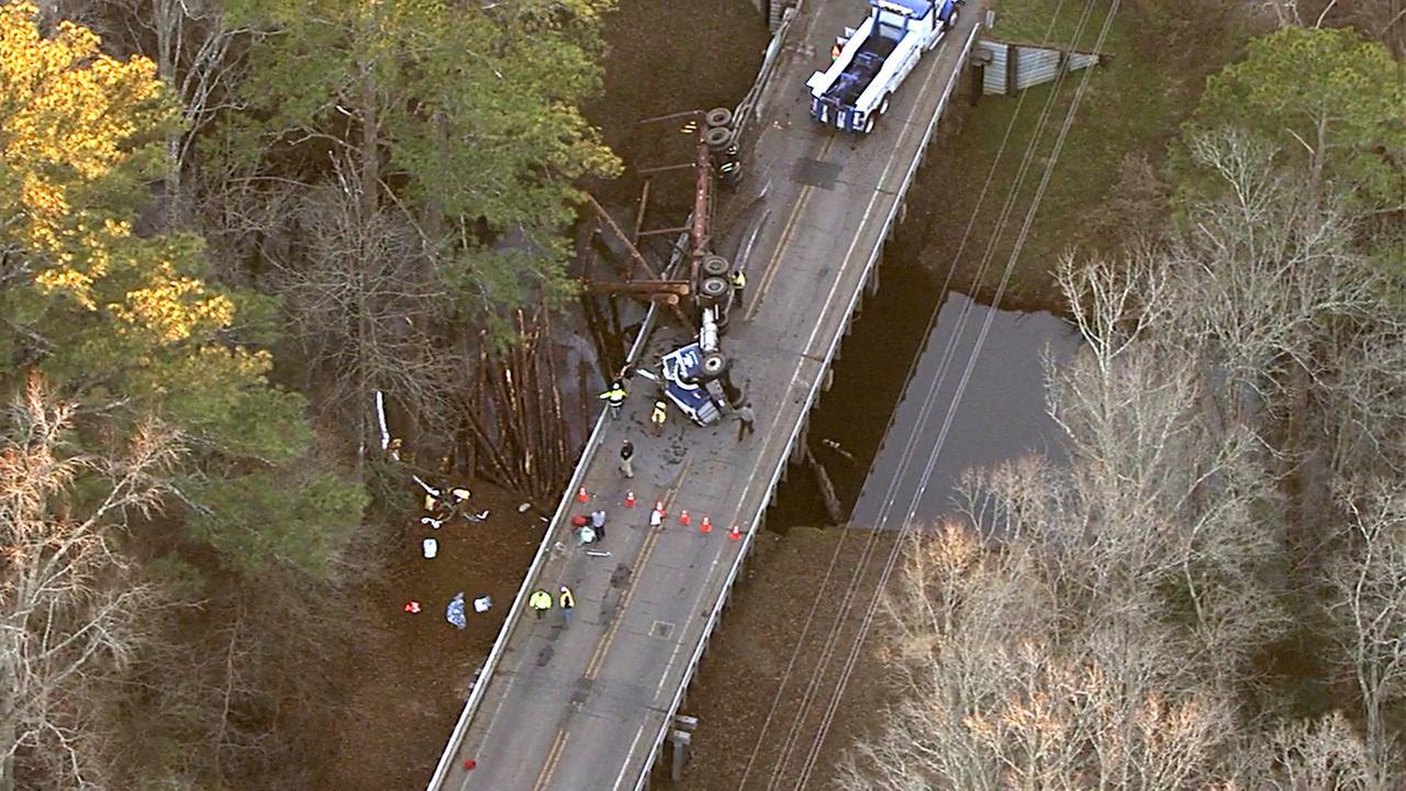 truck crash com log truck overturns on halifax county bridge