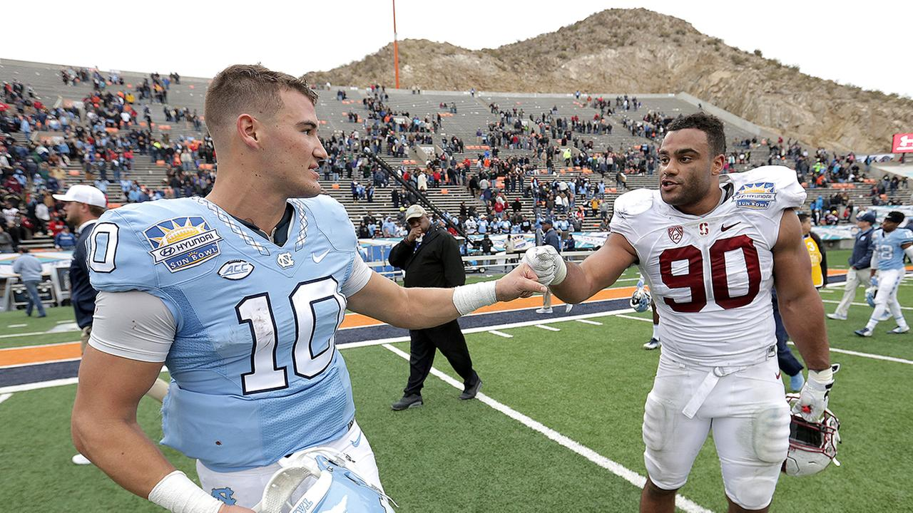 North Carolina quarterback Mitch Trubisky, left, and Stanford defensive lineman Solomon Thomas acknowledge each other after a hard-fought game in El Paso.