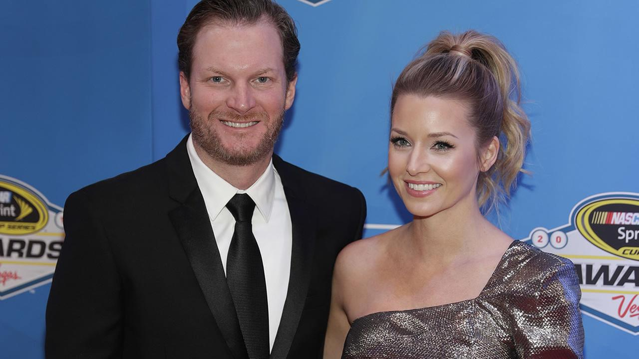 Dale Earnhardt Jr. and Amy Reimann pose on the red carpet during the NASCAR  Sprint