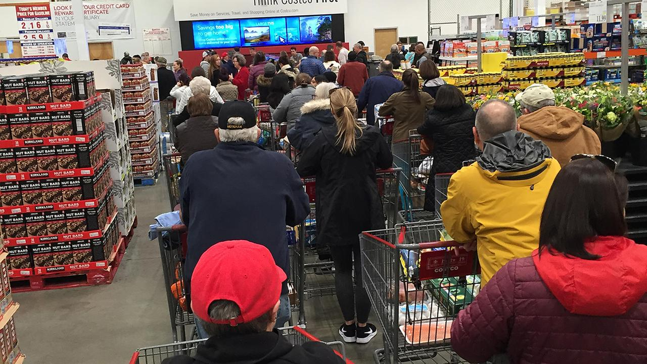 Long lines stretching halfway back through Costco to buy the weather essentials.Melissa Champlion/ABC11 Eyewitness