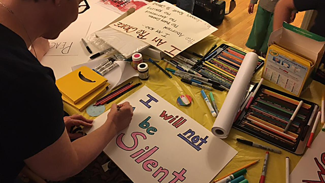 Stella Boswell and her daughter made signs to take to DC.