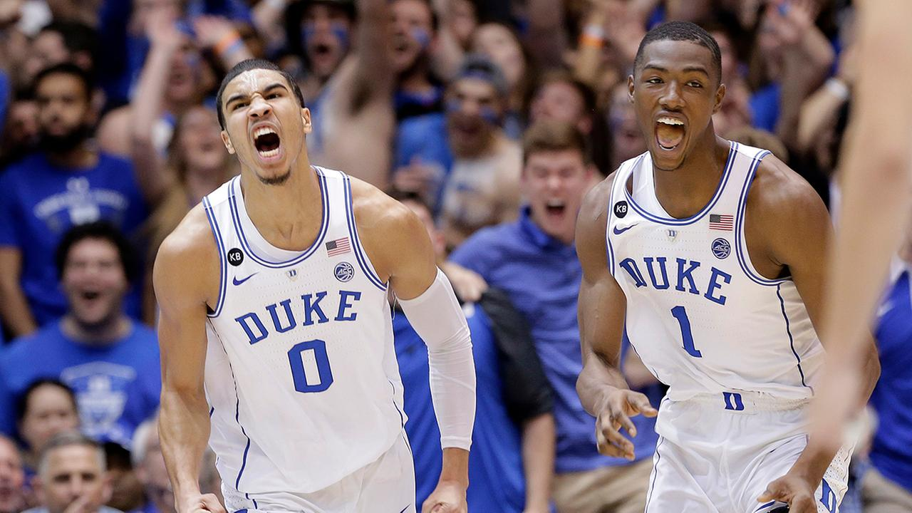 Dukes Jayson Tatum (0) and Harry Giles (1) had plenty of reason to be excited Thursday night.Gerry Broome